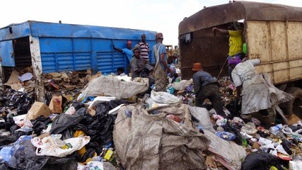 LACK OF HYGIENE DUE TO THE HEAP OF GARBAGE NEAR ANGLICAN CHURCH